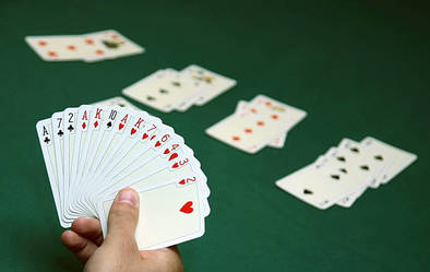 A player holding their hand of cards.